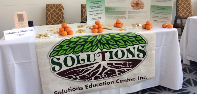 At A Community Event - Solutions Education Center